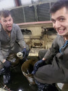 "(credit: Cpl Kelton Watson) – Cpl Jonathan ""Oh Face"" Langlands and Cpl Kelton ""Stop and Take a Selfie"" Watson bravely wade through a Leo-2 chassis as part of the week's maintenance push."